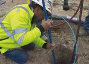 Installing cathodic protection systems onto large pipes involves connecting the pipes to bags of magnesium or zinc with wires.