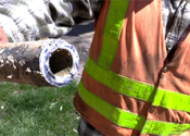 Denver water employee holding lead pipe.