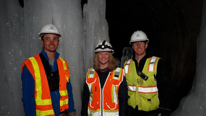 Denver Water team stands next to large ice formations in outlet tunnel underneath Dillon Dam