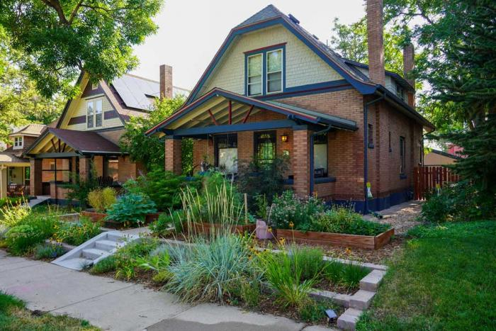 The front lawn of a home has been filled with a terraced garden full of water-wise plants.