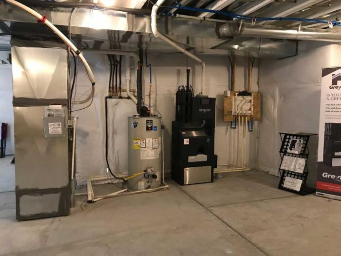 A basement wall lined with equipment to reuse and recycle water.