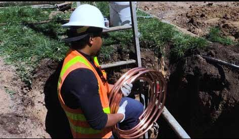 Denver Water worker replaces lead service line with copper.
