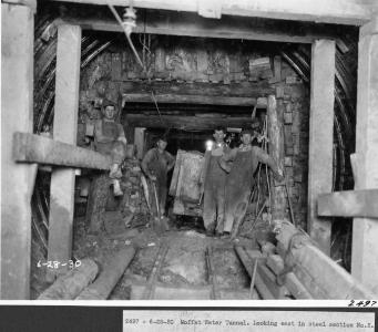 Workers inside the Moffat Tunnel in 1924.