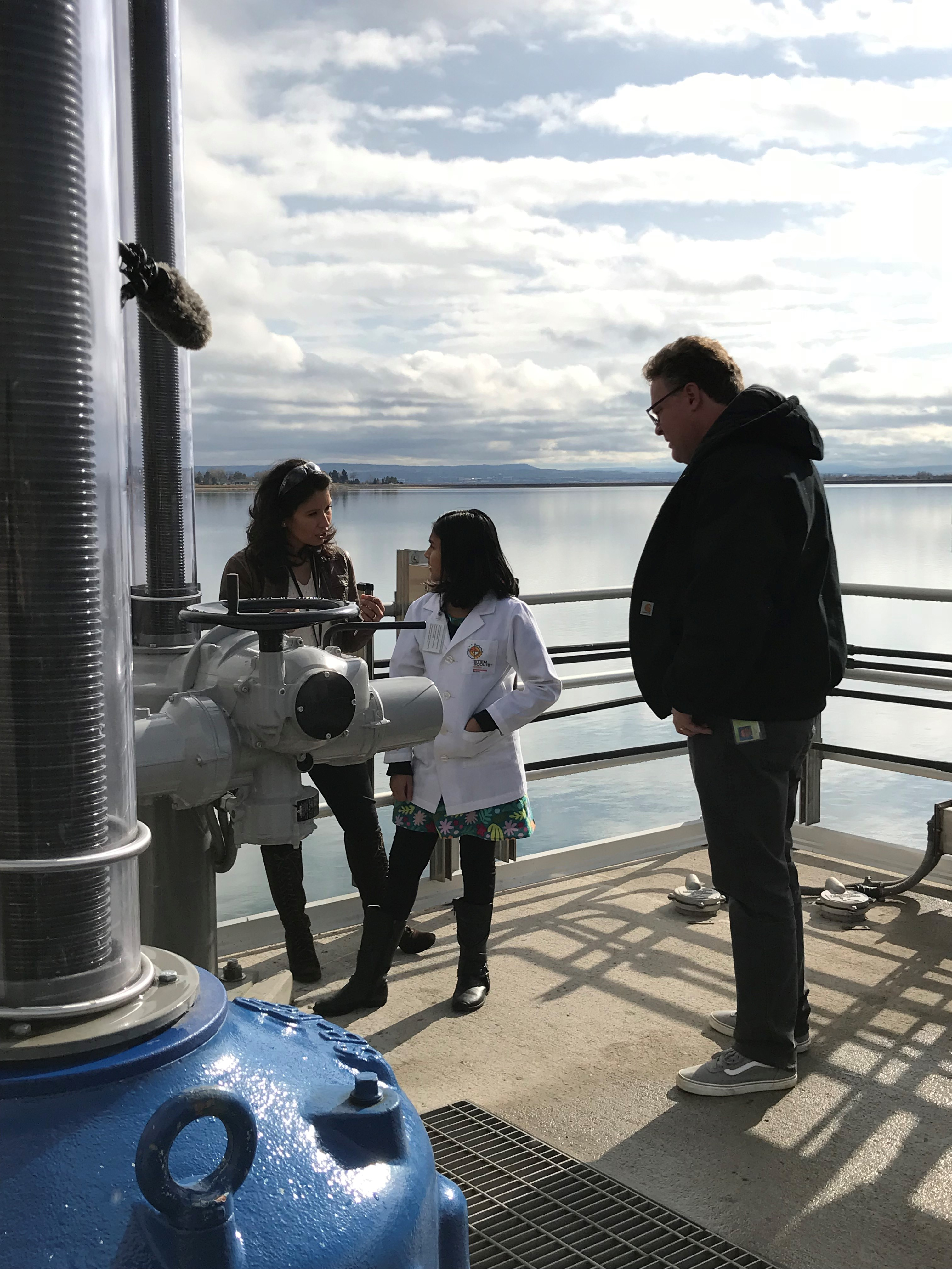 Selene Hernandez Ruiz, Denver Water's water quality lab manager (left), and Matt Bond, Denver Water's youth education manager (right), show how mountain water goes into the Marston Treatment Plant.