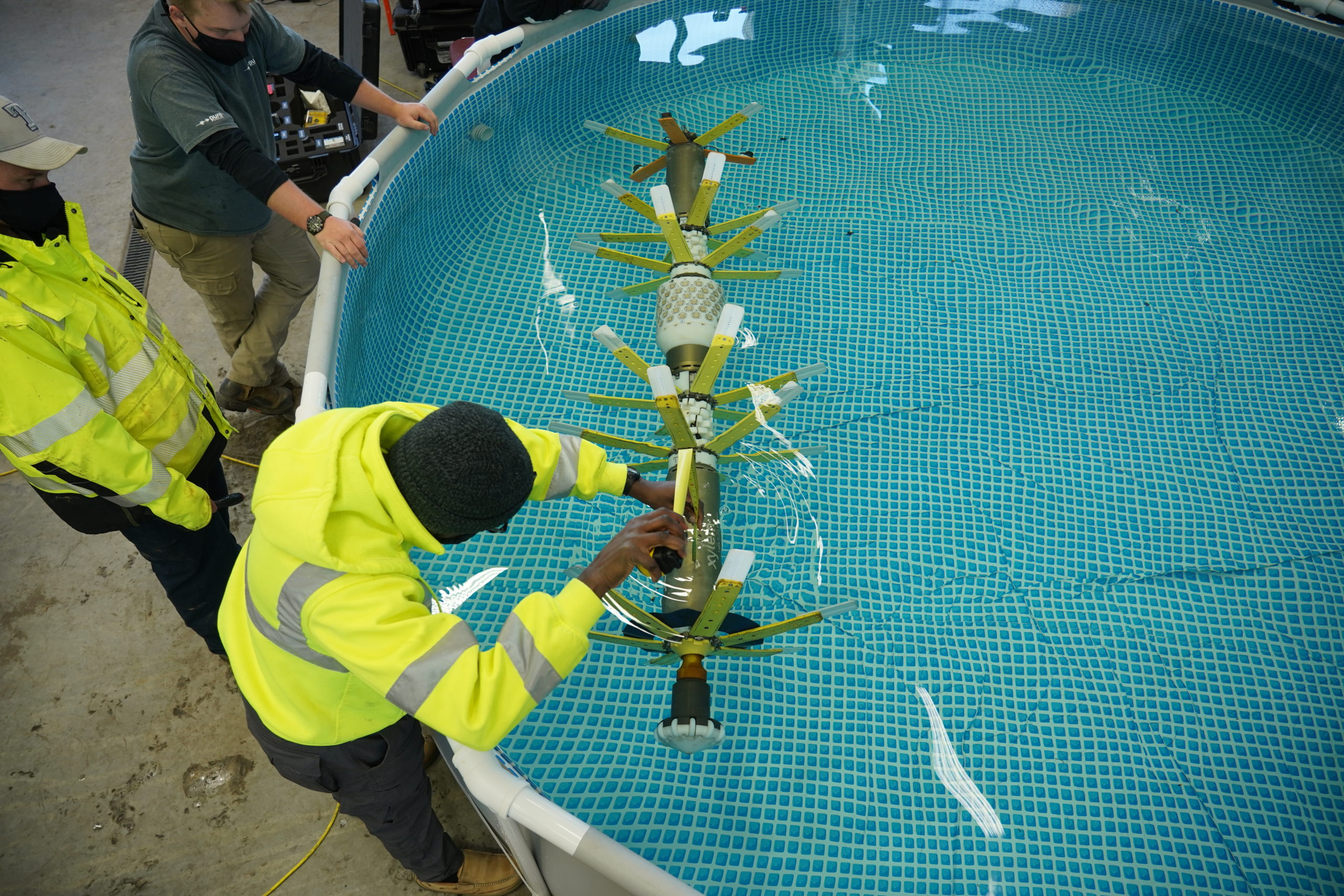 A Pure Technologies worker checks the balance of the PipeDiver in a pool before inspection. Photo credit: Denver Water.