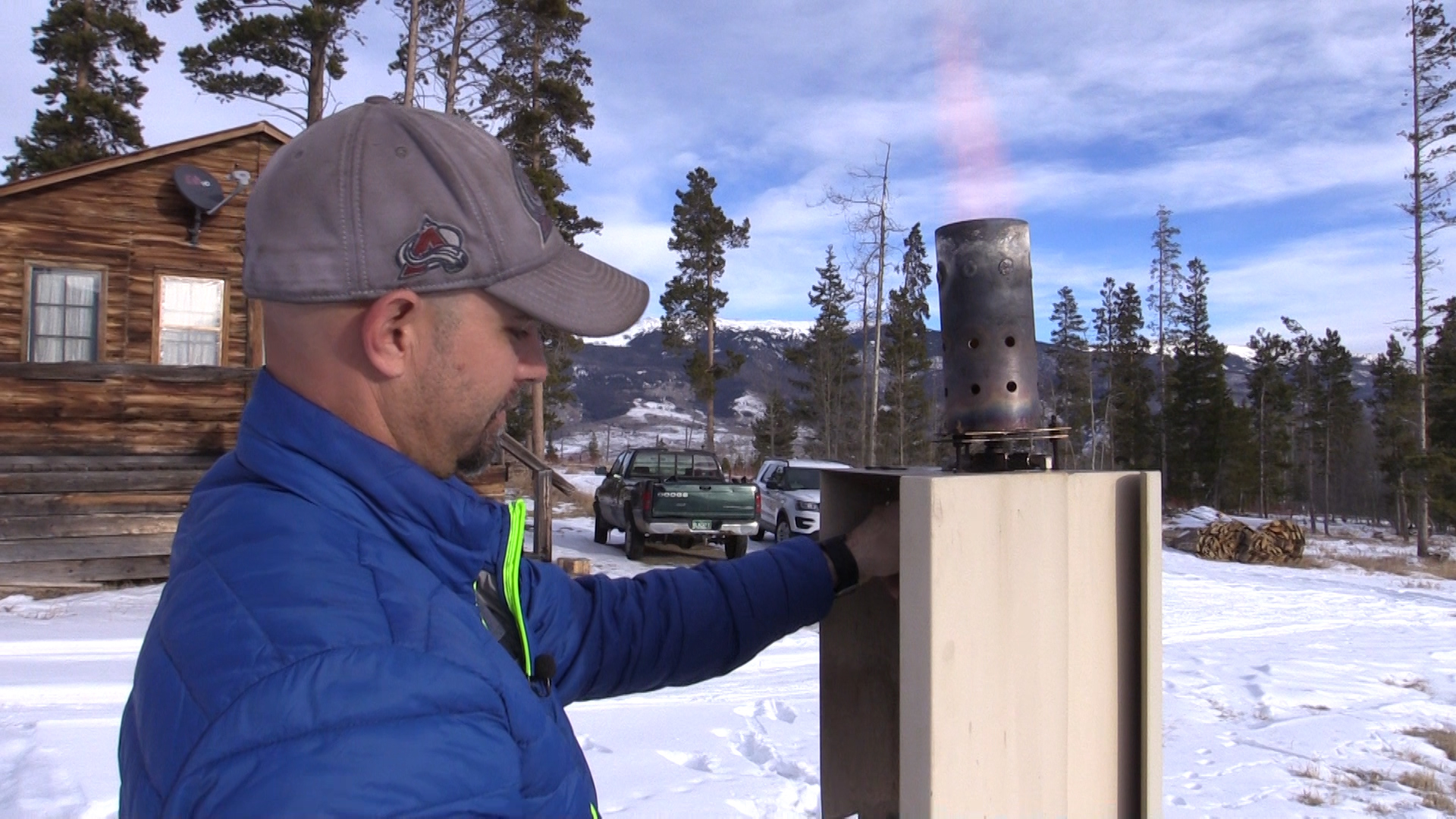 Eric Hjermstad, field operations director, Western Weather Consultants, lights a cloud seeding generator north of Silverthorne, Colorado.