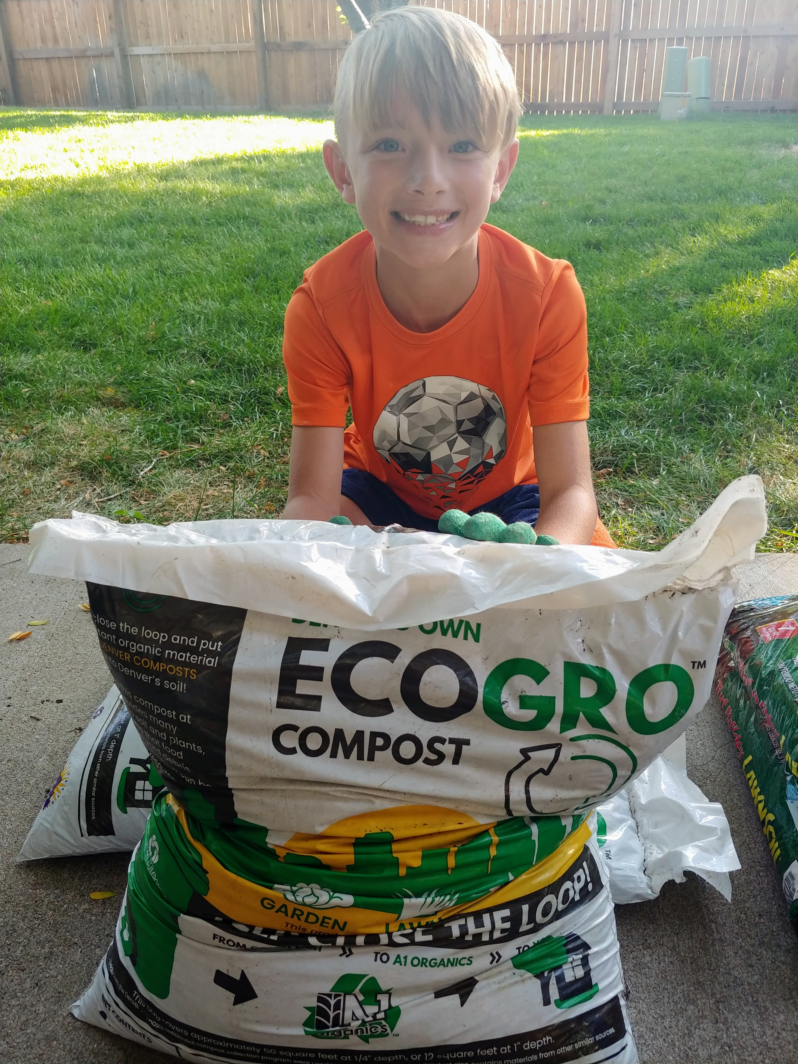 Keaton Delynko, 8, gets ready to put locally produced compost on the grass, to help his parents prep their lawn for a healthy, and water-conserving, spring.