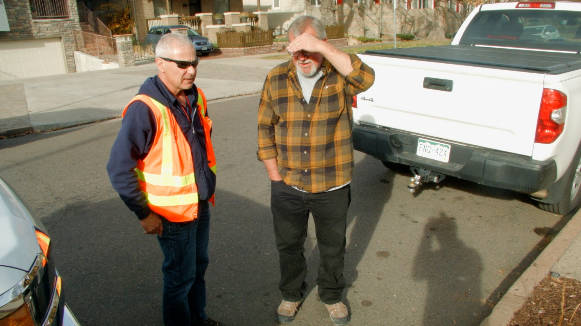 Jim Rael, senior customer service field technician, meets with a Denver Water customer to check for leaks inside the home.