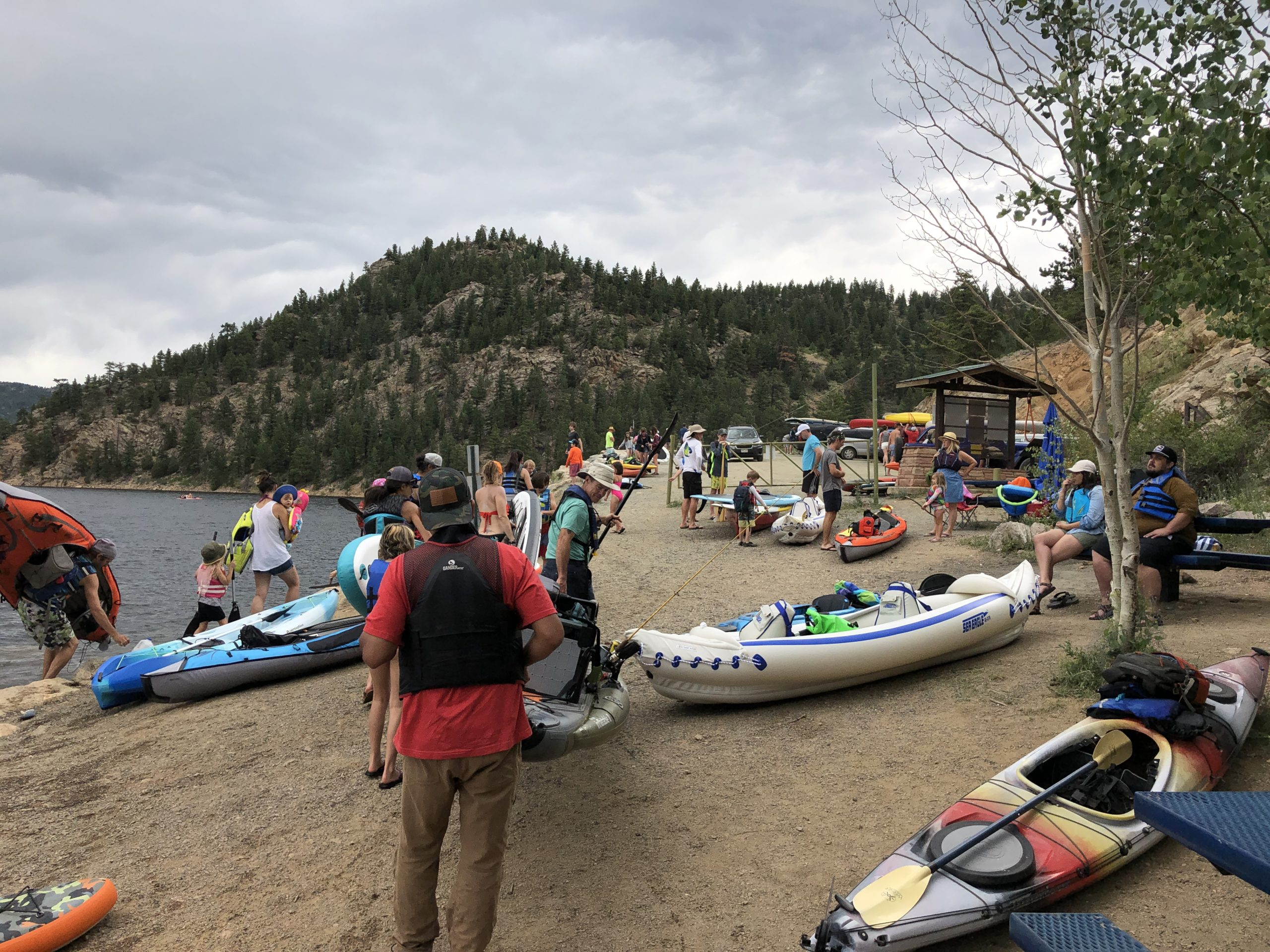 A boat ramp with people crowded around.