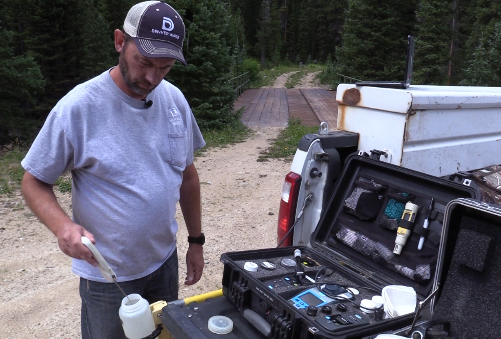 Nick Riney, water quality technician, performs several tests in the field during a watershed sampling visit to Grand County, Colorado.