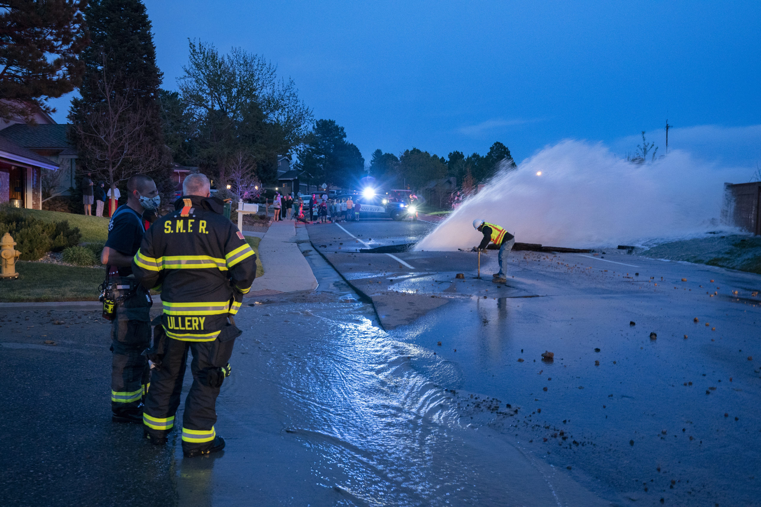 Firefighters from South Metro Fire and Rescue assisted with public safety while Denver Water crews turned off water from the break. Photo credit: South Metro Fire and Rescue.