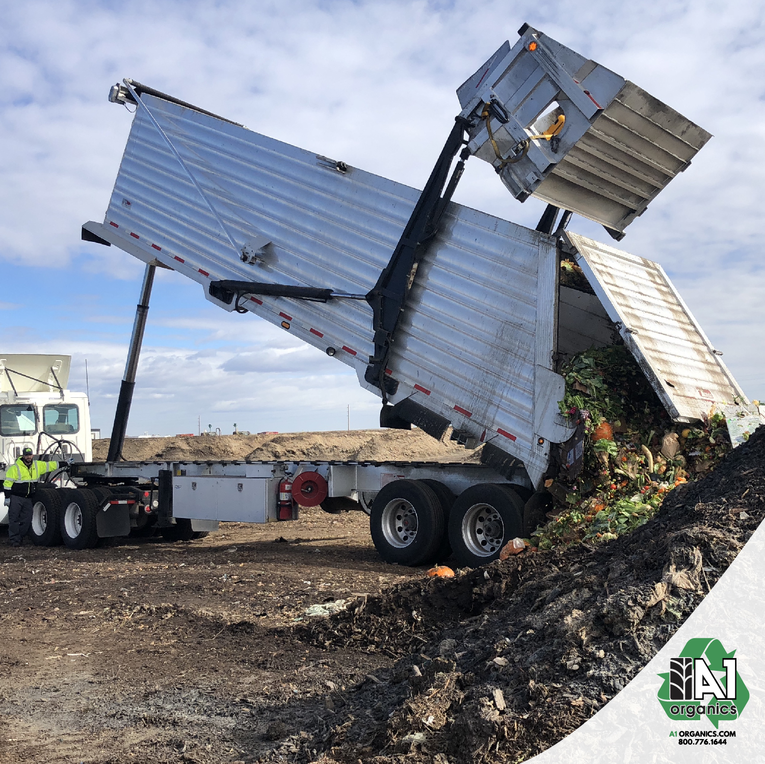 A fresh load of compostable materials is added to the windrows at A1 Organics' facility northeast of Denver.